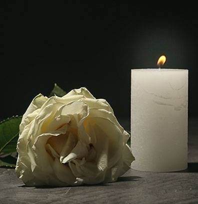 candle and flower to represent the private chapel of rest